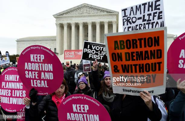 Prochoice and prolife activists demonstrate in front of the the US Supreme Court during the 47th annual March for Life on January 24 2020 in...
