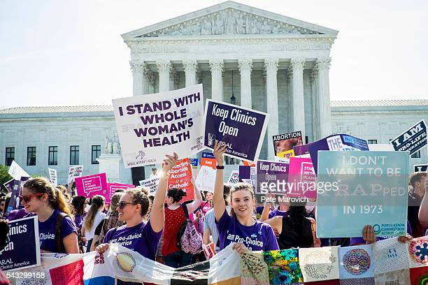 Prochoice and prolife activists demonstrate on the steps of the United States Supreme Court on June 27 2016 in Washington DC In a 53 decision the US...