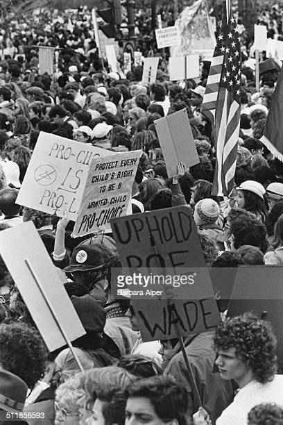 Prochoice campaigners at a March for Women's Equality in Washington DC 9th April 1989 One placard refers to the landmark case of Roe Vs Wade...