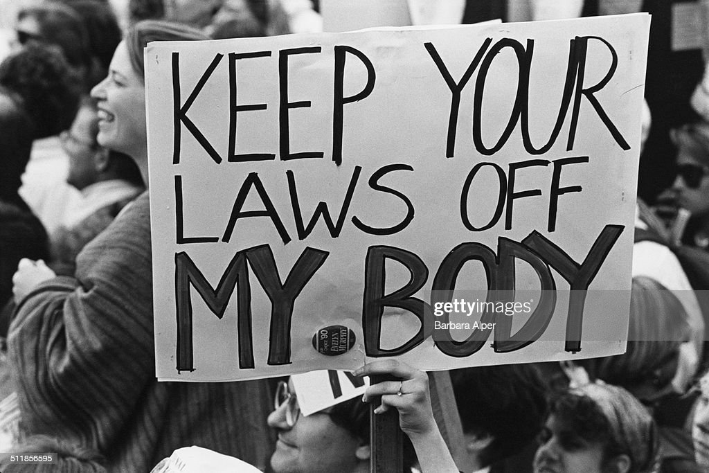 Pro-choice campaigners at a March for Women's Equality in Washington, DC, 9th April 1989. One placard reads 'Keep your laws off my body'.