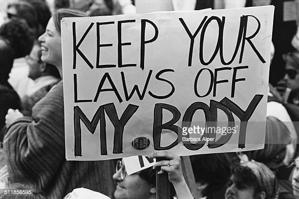 Prochoice campaigners at a March for Women's Equality in Washington DC 9th April 1989 One placard reads 'Keep your laws off my body'