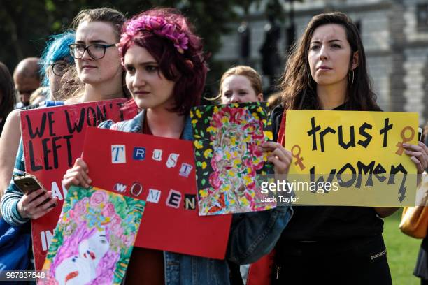 Prochoice campaigners hold placards outside the Houses of Parliament during a demonstration to urge the Government to extend the same laws on...