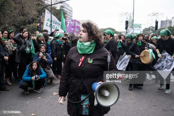 A prochoice demonstrator holds a megaphone while gathering during a protest outside of the National Congress building in Buenos Aires Argentina on...