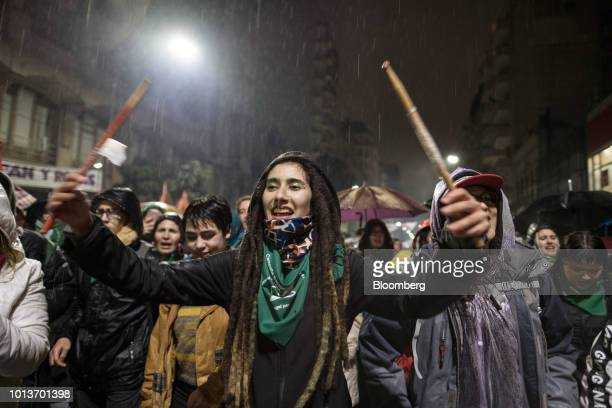 A prochoice demonstrator holds drum sticks during a protest outside of the National Congress building in Buenos Aires Argentina on Wednesday Aug 8...