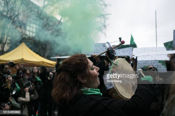 A prochoice demonstrator plays a drum during a protest outside of the National Congress building in Buenos Aires Argentina on Wednesday Aug 8 2018...