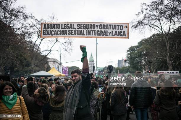 A prochoice demonstrator raises a fist while gathering during a protest outside of the National Congress building in Buenos Aires Argentina on...