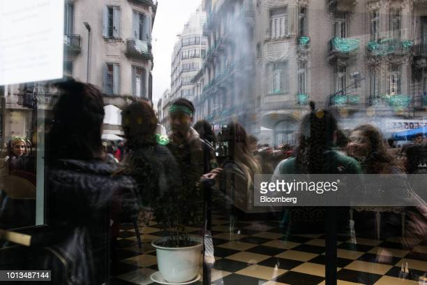 Prochoice demonstrators are seen reflected on a shop window during a protest outside of the National Congress building in Buenos Aires Argentina on...
