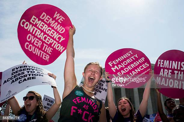 Prochoice demonstrators at the US Supreme Court cheer as they learn the court struck down the Texas abortion law on Monday June 27 2016