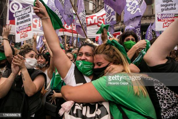 Pro-choice demonstrators celebrate after lower house representatives give half sanction to a bill to legalize abortion on December 11, 2020 in Buenos...