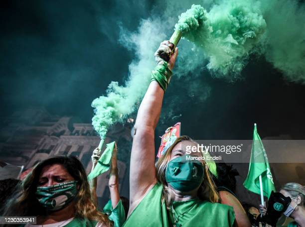 Pro-choice demonstrators celebrate after the right to an abortion is legalized on December 30, 2020 in Buenos Aires, Argentina. The proposal...