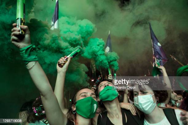Pro-choice demonstrators celebrate with green fumes after the right to an abortion is legalized on December 29, 2020 in Buenos Aires, Argentina. The...