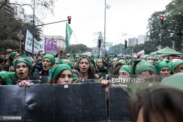 Prochoice demonstrators hold signs and chant during a protest outside of the National Congress building in Buenos Aires Argentina on Wednesday Aug 8...