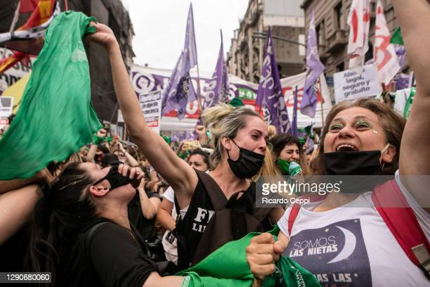 Pro-choice demonstrators hold up green kerchiefs and shout slogans to celebrate as Deputies give half sanction to a bill to legalize abortion on...