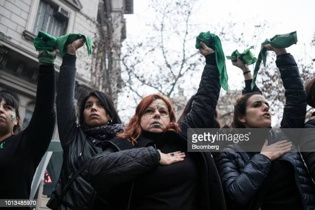 Prochoice demonstrators raise green handkerchiefs during a protest outside of the National Congress building in Buenos Aires Argentina on Wednesday...