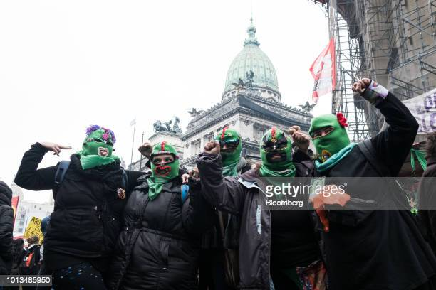 Prochoice demonstrators wear green masks during a protest outside of the National Congress building in Buenos Aires Argentina on Wednesday Aug 8 2018...