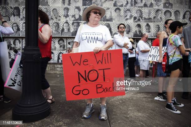 ProChoice protester holds a sign reading We will not go back before the March For Reproductive Freedom rally in Montgomery Alabama May 19 2019 The...