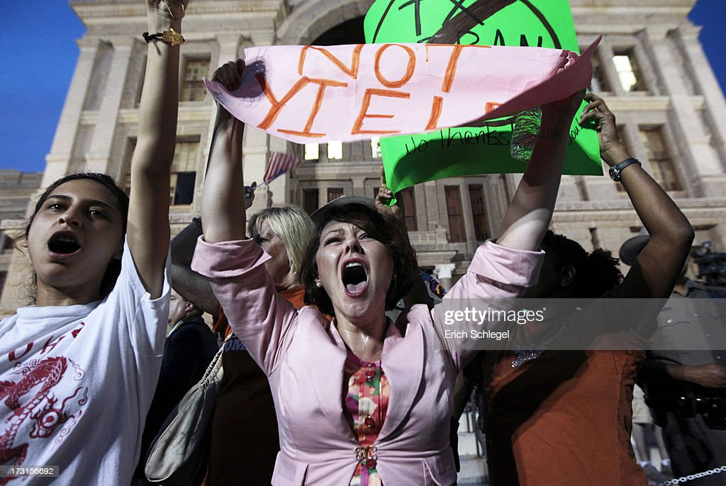 Pro-choice protester Julia Ann Nitsch of Austin, center, chants as pro-life supporters and pro-choice protesters rally at the Texas state capitol in favor and against the new controversial abortion legislation up for a vote in the state legislature on July 8, 2013 in Austin Texas. Texas Gov. Rick Perry called on a second legislative special session to pass an restrictive abortion law through the Texas legislature. The first attempt was defeated after opponents of the law were able to stall the vote until after first special session had ended.