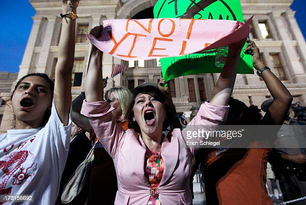 Prochoice protester Julia Ann Nitsch of Austin center chants as prolife supporters and prochoice protesters rally at the Texas state capitol in favor...