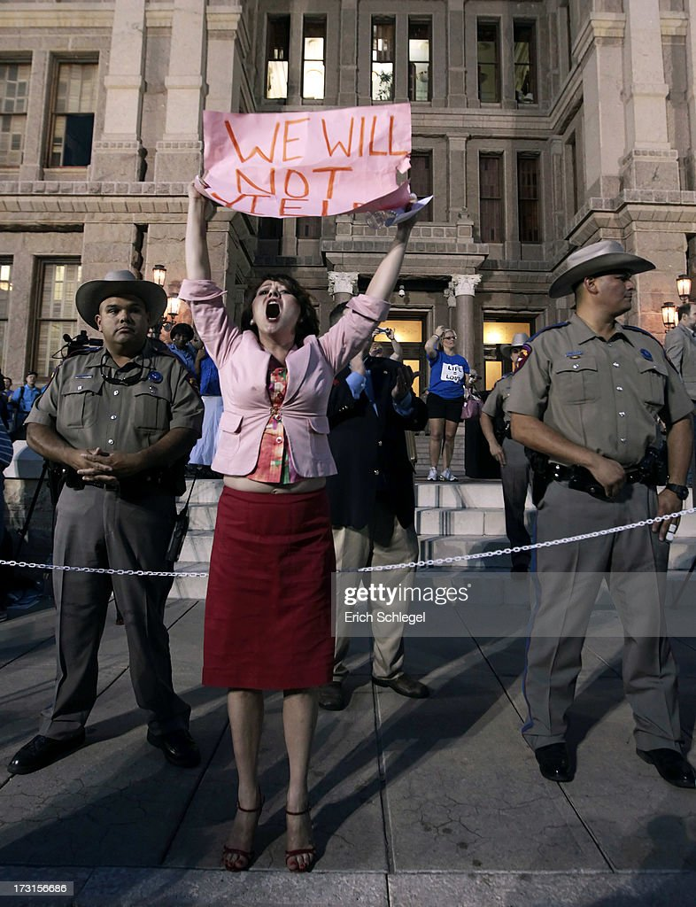 Pro-choice protester Julia Ann Nitsch of Austin chants as pro-life supporters and pro-choice protesters rally at the Texas state capitol in favor and against the new controversial abortion legislation up for a vote in the state legislature on July 8, 2013 in Austin Texas. Texas Gov. Rick Perry called on a second legislative special session to pass an restrictive abortion law through the Texas legislature. The first attempt was defeated after opponents of the law were able to stall the vote until after first special session had ended.