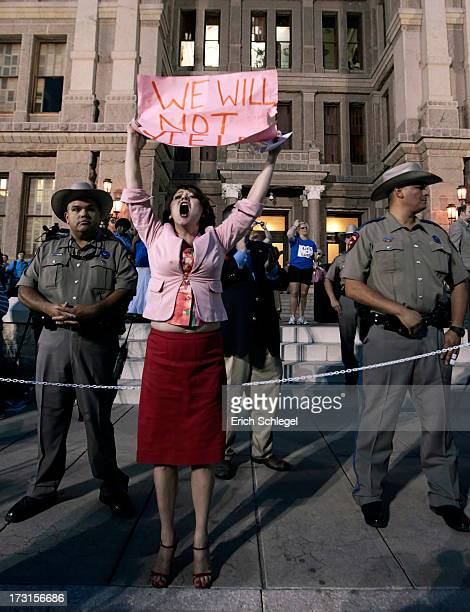 Prochoice protester Julia Ann Nitsch of Austin chants as prolife supporters and prochoice protesters rally at the Texas state capitol in favor and...