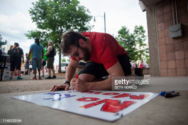 A prochoice protester makes a sign before the March For Reproductive Freedom in Montgomery Alabama May 19 2019 The state of Alabama passed a...