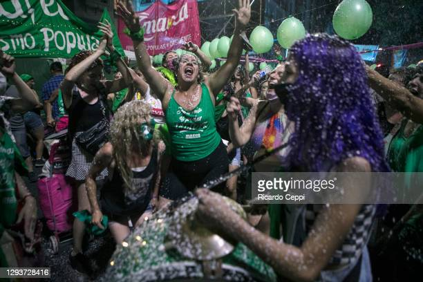 Pro-choice protesters dance outside the National Congress as senators decide on the legalization of abortion on December 30, 2020 in Buenos Aires,...