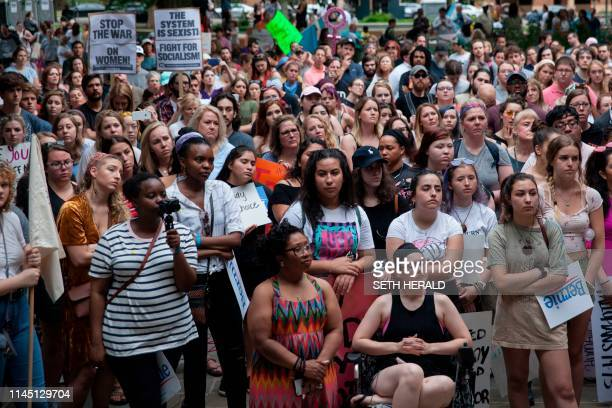 ProChoice protesters gather at Ingram Park in Birmingham Alabama after the March For Reproductive Freedom on May 19 2019 The state of Alabama passed...
