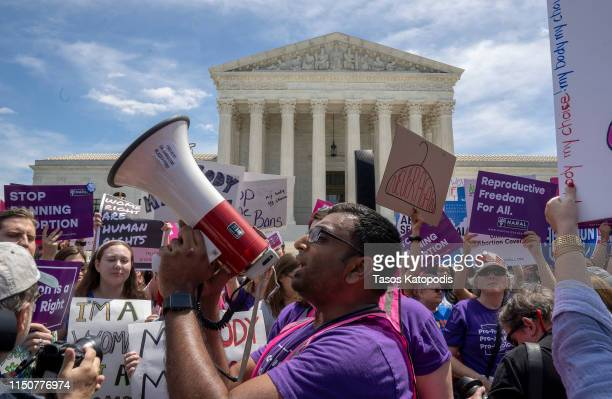Prochoice protesters gather at the Supreme Court on May 21 2019 in Washington DC The Alabama abortion law signed by Gov Kay Ivey last week includes...