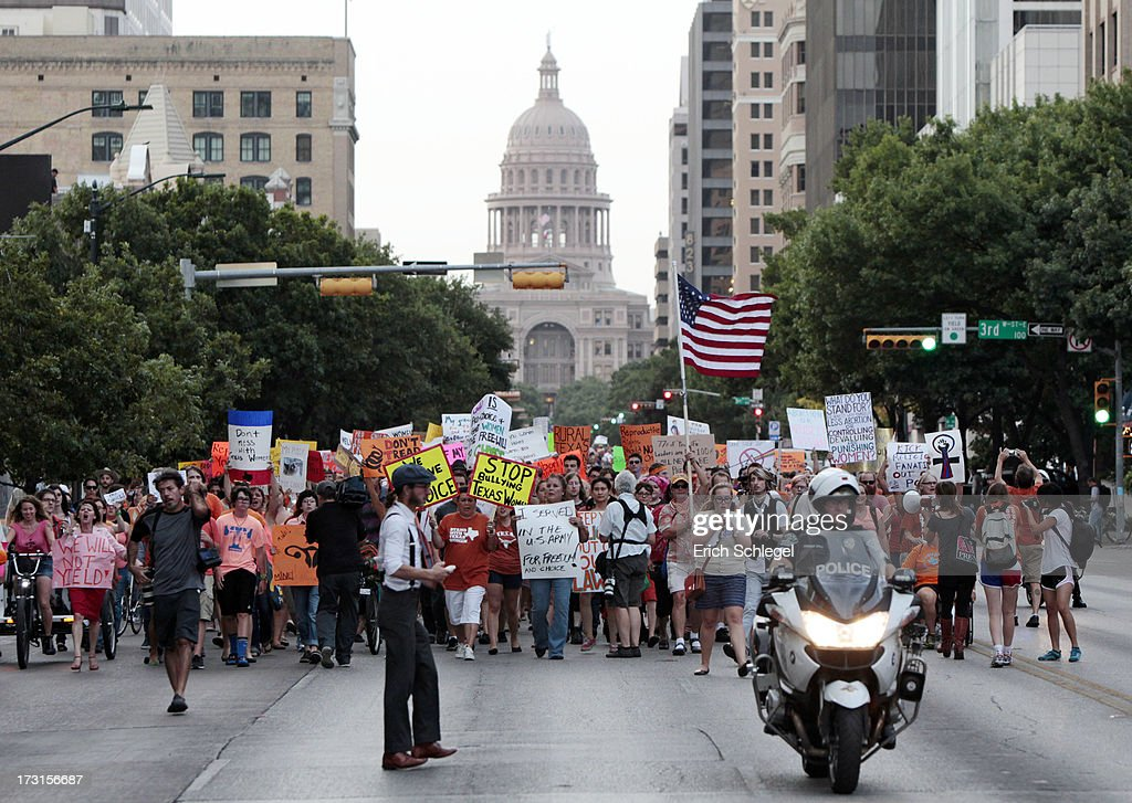 Pro-choice protesters march down Congress Avenue and back to the Texas state capitol as pro-life supporters and pro-choice protesters rally at the Texas state capitol in favor and against the new controversial abortion legislation up for a vote in the state legislature, on July 8, 2013 in Austin Texas. Texas Gov. Rick Perry called on a second legislative special session to pass an restrictive abortion law through the Texas legislature. The first attempt was defeated after opponents of the law were able to stall the vote until after first special session had ended.