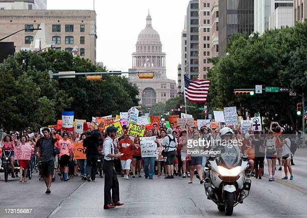 Prochoice protesters march down Congress Avenue and back to the Texas state capitol as prolife supporters and prochoice protesters rally at the Texas...