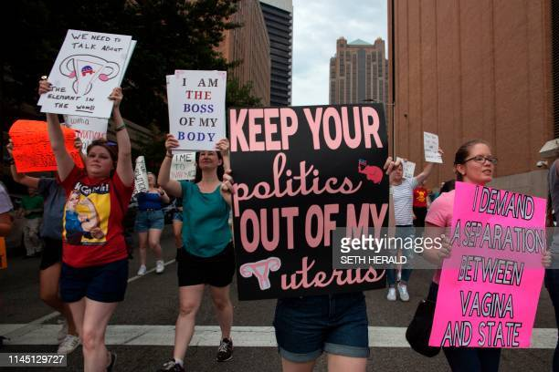 ProChoice protesters march through the streets of Birmingham Alabama during the March For Reproductive Freedom on May 19 2019 The state of Alabama...