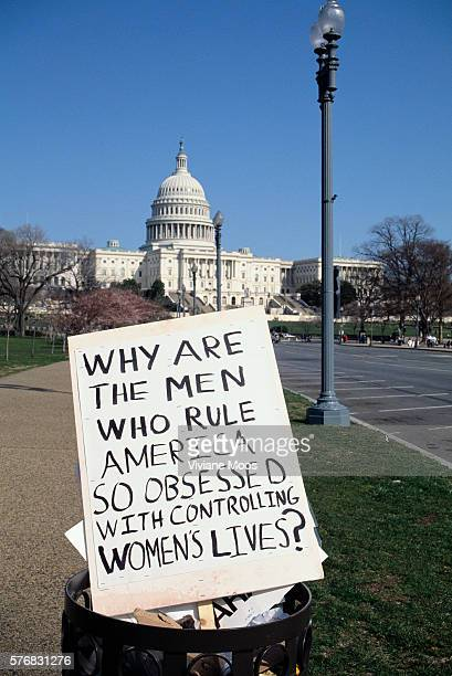A prochoice sign is discarded in a garbage can near the US Capitol after an abortion rights march The sign reads 'Why Are the Men Who Rule America So...