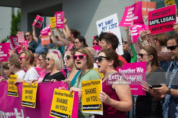 ProChoice supporters along with Planned Parenthood staff celebrate and rally outside the Planned Parenthood Reproductive Health Services Center on...