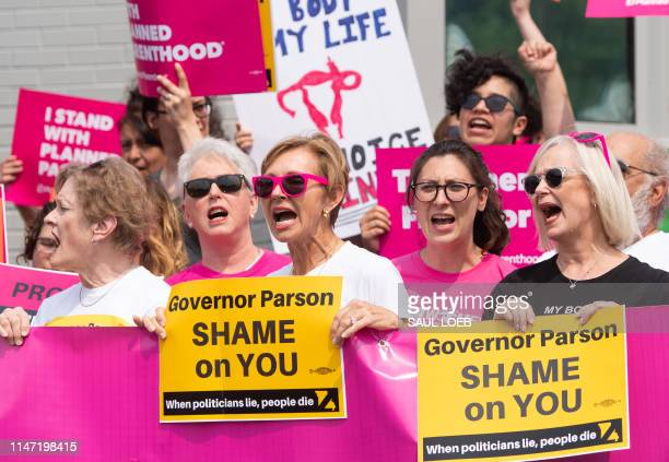 Pro-choice supporters and staff of Planned Parenthood hold a rally outside the Planned Parenthood Reproductive Health Services Center in St. Louis,...