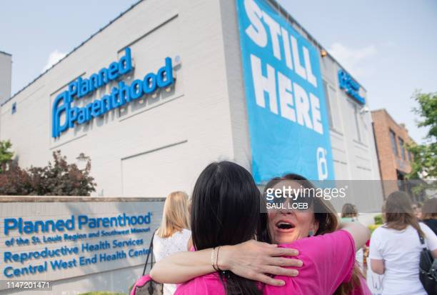 Prochoice supporters hug outside the Planned Parenthood Reproductive Health Services Center in St Louis Missouri May 31 the last location in the...