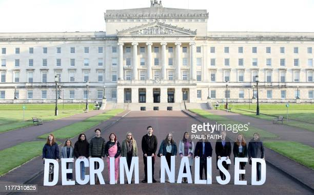 Prochoice supporters pose as they gather at Parliament buildings on the Stormont Estate in Belfast on October 21 as some of Stormont's assembly...