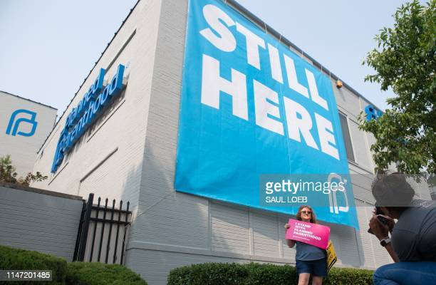 Prochoice supporters pose for photos outside the Planned Parenthood Reproductive Health Services Center in St Louis Missouri May 31 the last location...