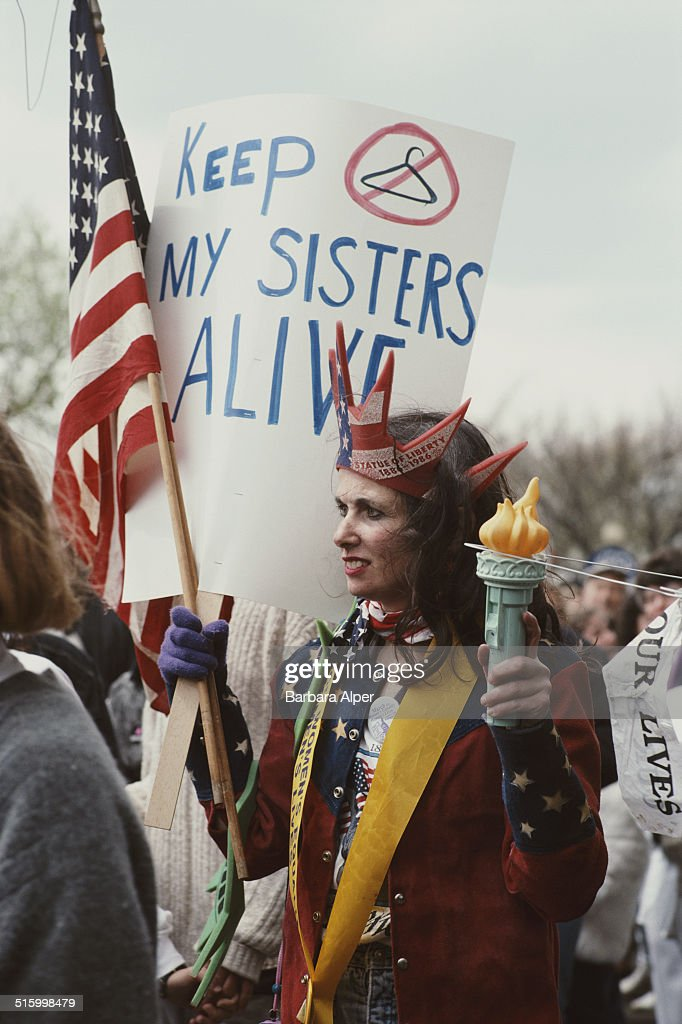 Pro-Choice supporters take part in a March for Women's Equality in Washington, DC, 9th April 1989. One supporter is dressed as the Statue of Liberty with a placard reading 'Keep my sisters alive'.