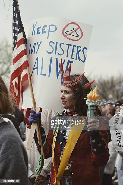 ProChoice supporters take part in a March for Women's Equality in Washington DC 9th April 1989 One supporter is dressed as the Statue of Liberty with...