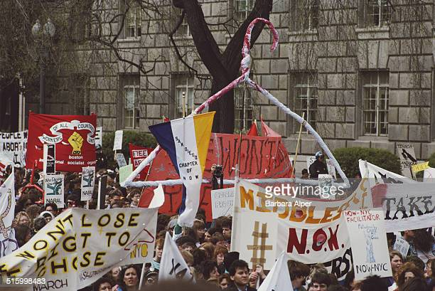 ProChoice supporters take part in a March for Women's Equality in Washington DC 9th April 1989 They are carrying a huge representation of a bloody...