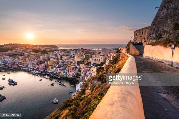 procida at sunset, gulf of naples, italy - naples italie photos et images de collection