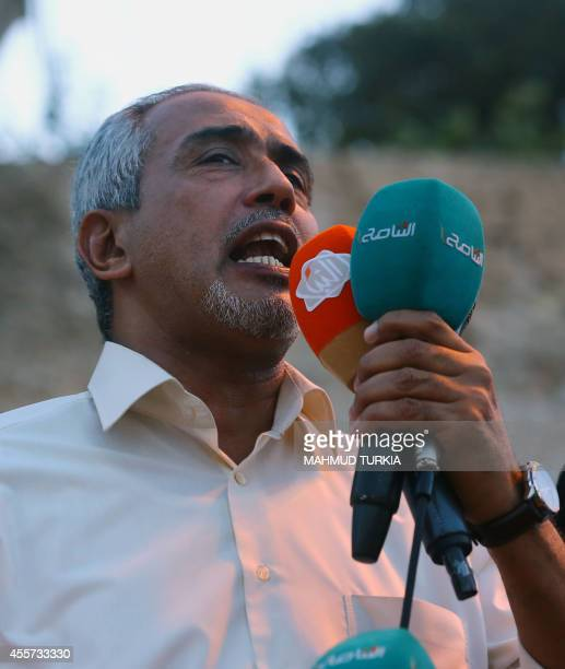 Proclaimed proIslamist prime minister Omar alHassi addresses the crowd during a rally in Tripoli's central Martyr's Square on September 19 2014 in...