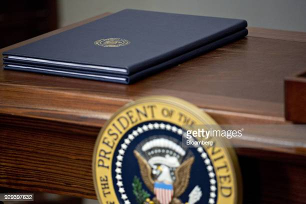Proclamations on adjusting imports of steel and aluminum sit on a desk before being signed by U.S. President Donald Trump in the Roosevelt Room of...