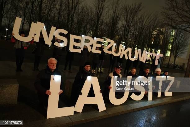 Procoal activists mainly workers from power plants and coal mines in the Lusatian region of eastern Germany hold a sign that reads 'Our Future...