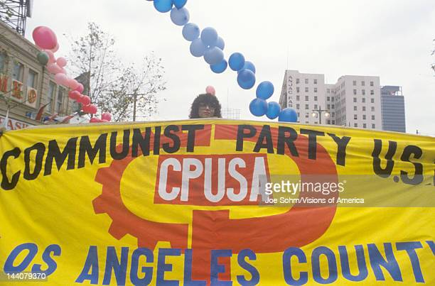 Procommunist marchers holding banner Los Angeles California