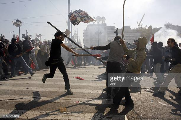 Procommunist union protesters clash with other demonstrators in Athens on October 20 2011 Clashes have broken out in central Athens between rival...