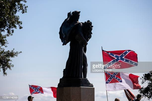 "Pro-Confederate flaggers from a group called ""Flags of the South"" hold a protest in front of The Confederate Defenders of Charleston statue at The..."