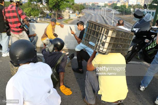 "Pro-coup supporters affected after an intervention with tear gas near the Generalisimo Francisco de Miranda Airbase ""La Carlota"", in Caracas,..."