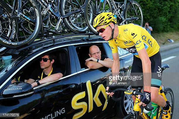 Procycling General Manager Sir Dave Brailsford and Sports Director Nicolas Portal speak with the winner of the 2013 Tour de France Chris Froome of...