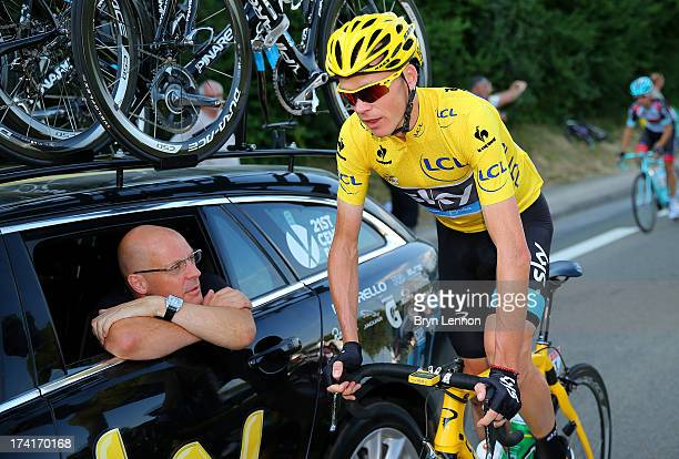 Procycling General Manager Sir Dave Brailsford speaks with the winner of the 2013 Tour de France, Chris Froome of Great Britain and SKY during the...